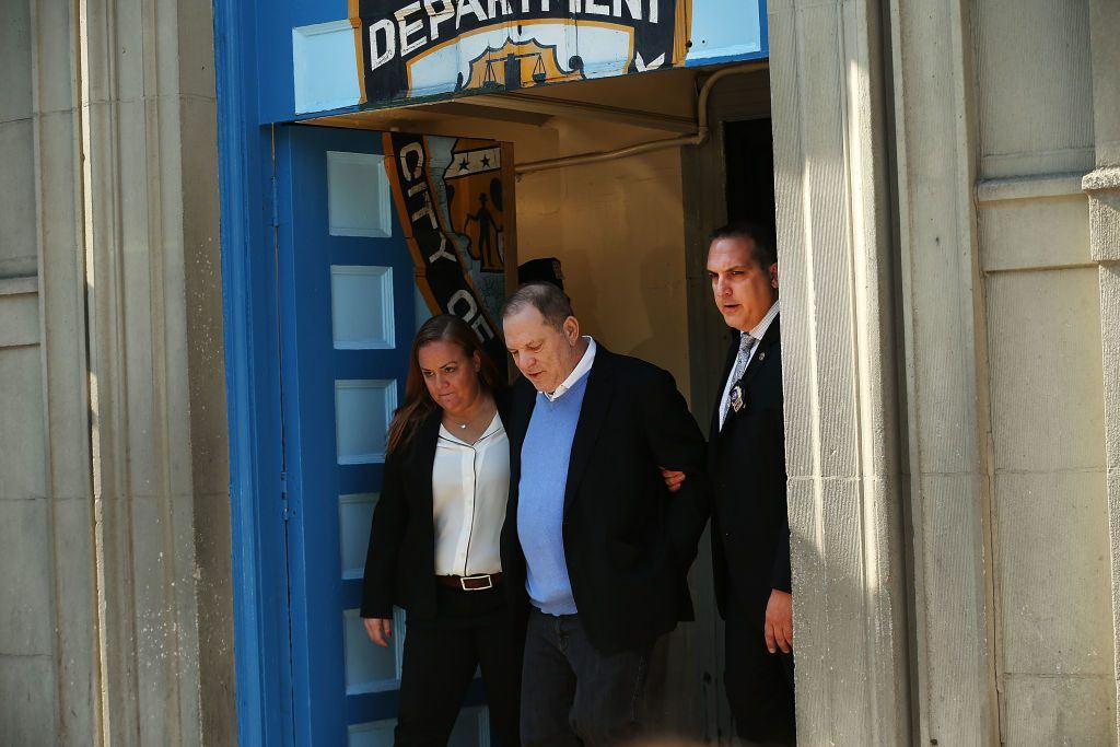 Harvey Weinstein is led out of the New York Police Department's First Precinct in handcuffs after being arrested and processed on charges of rape, committing a criminal sex act, sexual abuse and sexual misconduct on May 25, 2018 in New York City.