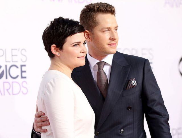 Ginnifer Goodwin and Josh Dallas posing together on a red carpet.