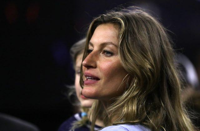 Gisele Bundchen turning to the side as she speaks on stage.