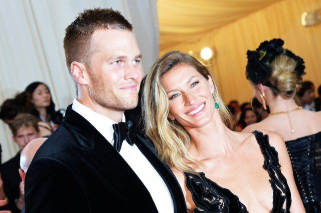 Tom Brady and Gisele Bundchen smiling at a MET Gala.