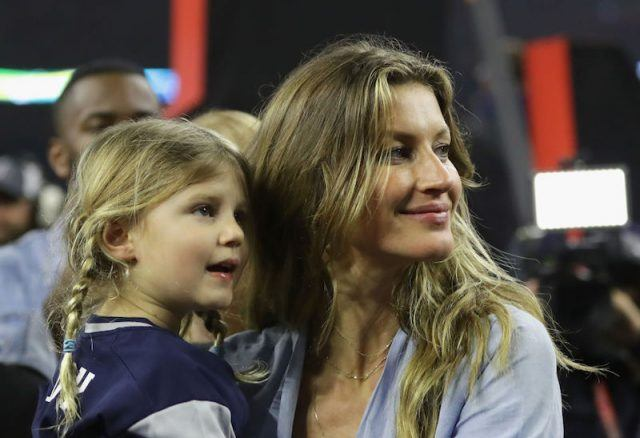 Gisele Bündchen and her daughter Vivian at a football game.