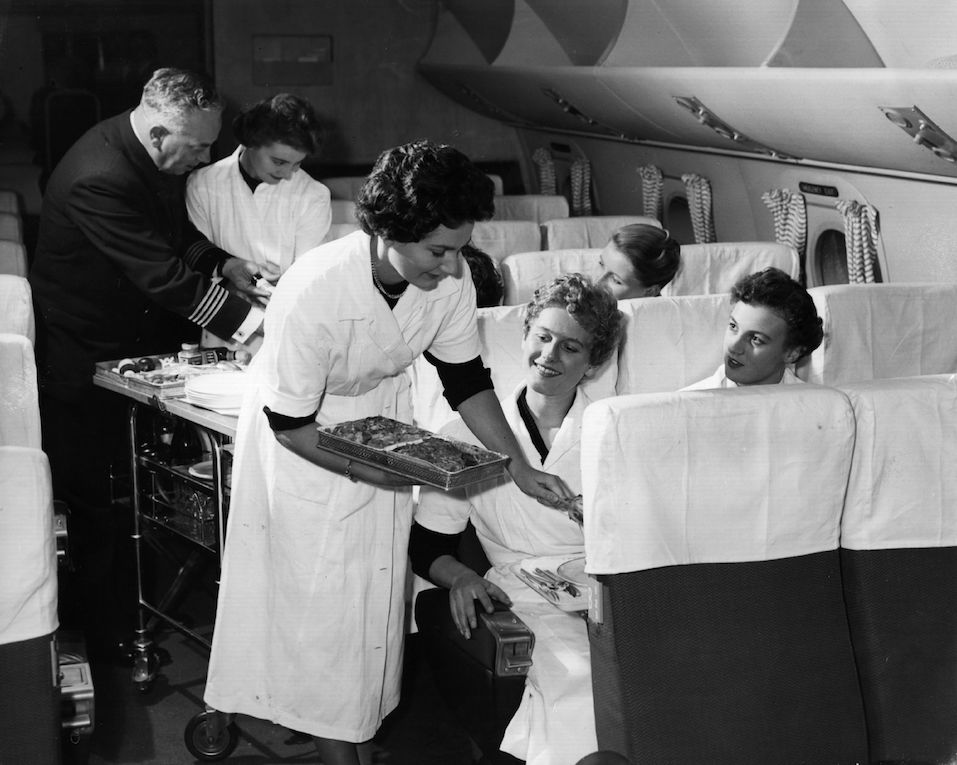 BOAC air hostesses in training are taught in a mock-up of an aircraft cabin at London Airport