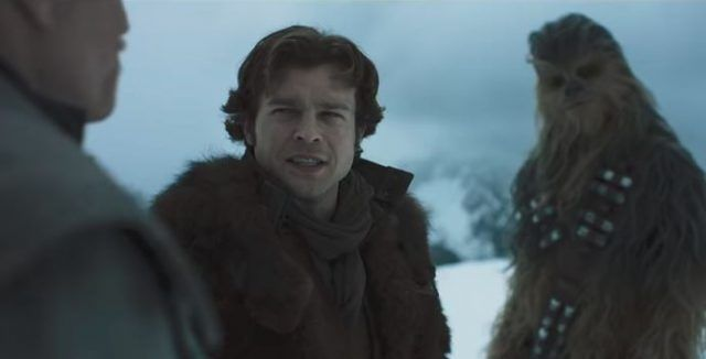 Han and Chewie stand on a snowy mountain.
