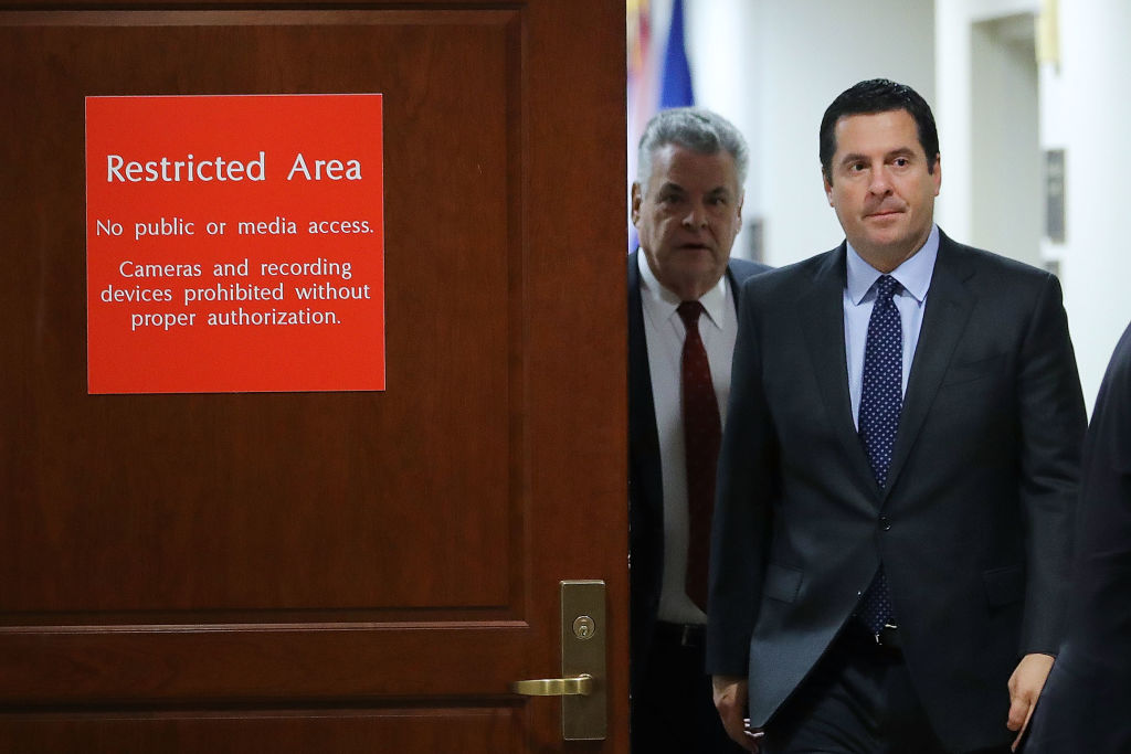 Chairman Devin Nunes and Rep. Peter King leave the committee's secure meeting rooms in the basement of the U.S. Capitol House Visitors Center