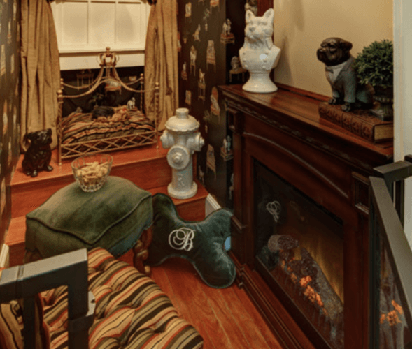 Paw cushions, dog statues and a wooden fireplace in a cozy den.