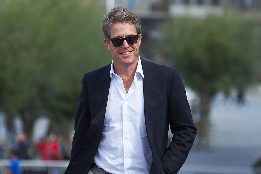 Actor Hugh Grant attends a photocall .