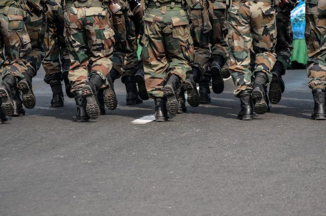 A group of soldiers running together.