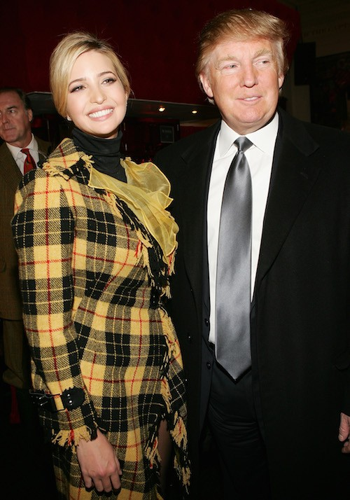 Ivanka Trump posing with Donald Trump at a fashion show.