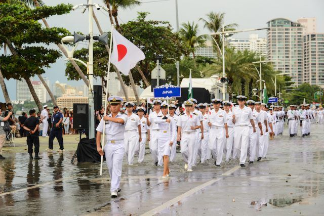 Japanese soldiers marching on the streets.