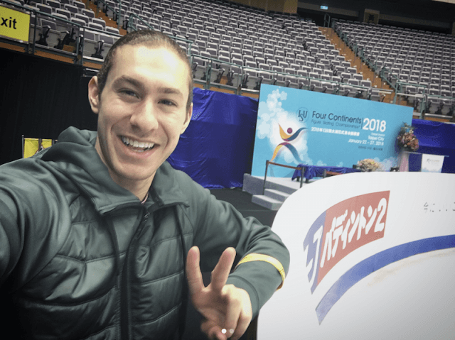 Jason Brown smiling at a skating rink.
