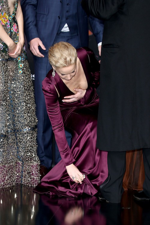 Jennifer Lawrence fixing her dress.