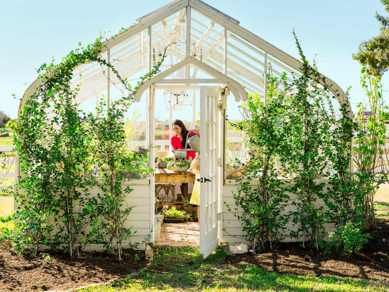 Joanna Gaines in her greenhouse