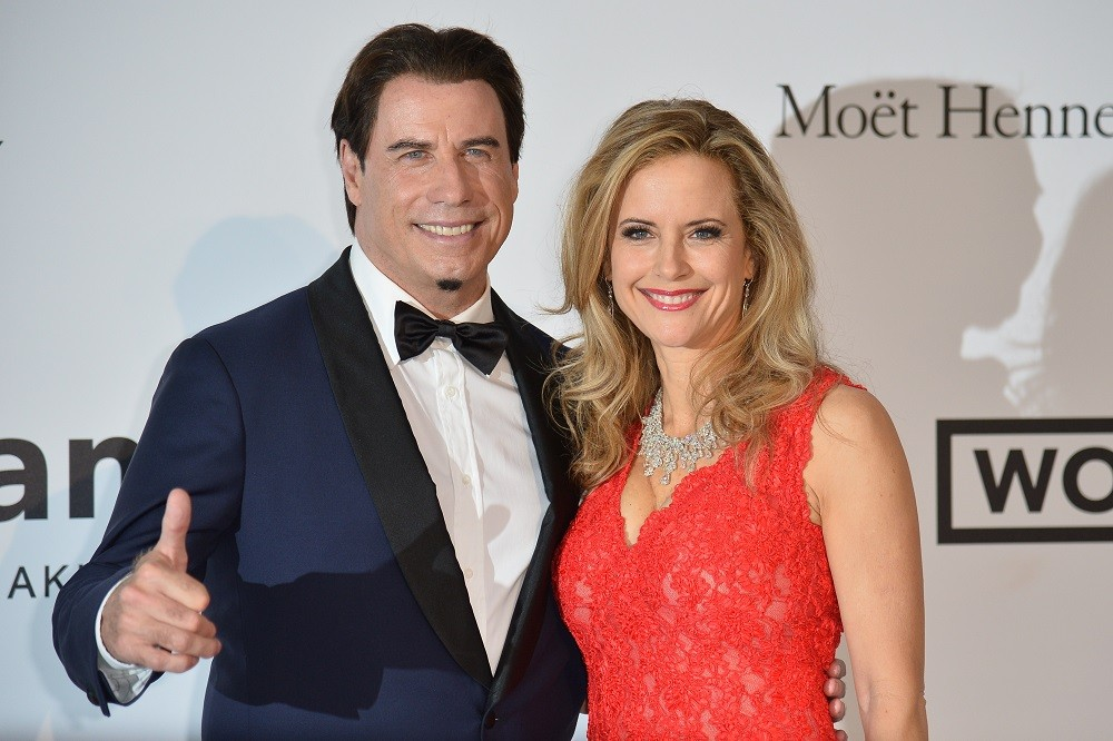 US actor John Travolta (L) and his wife US actress Kelly Preston