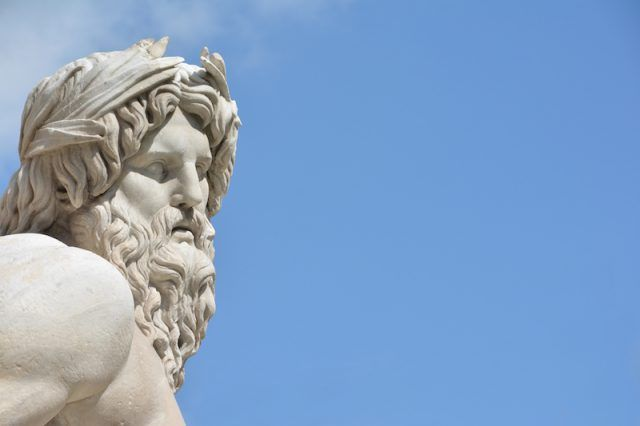 A statue of Jupiter seen on a clear blue day.