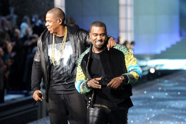 Kanye West and Jay-Z performing on stage.
