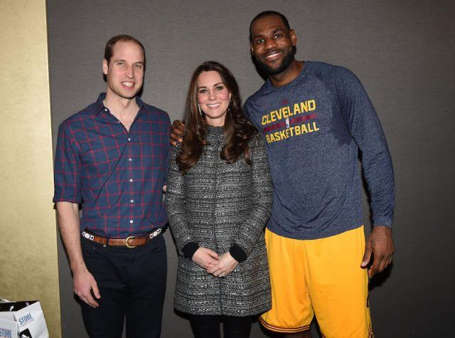 Prince Charles, Kate Middleton and LeBron James posing together for a photo.