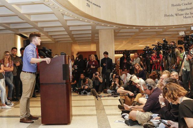 A student speaks at a podium at the Florida State Capitol.