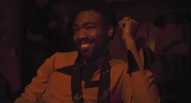 Donald Glover smiling brightly.