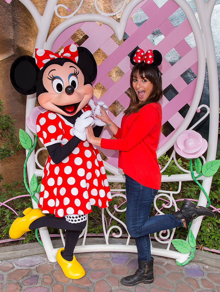 Actress Lea Michele poses with Minnie Mouse