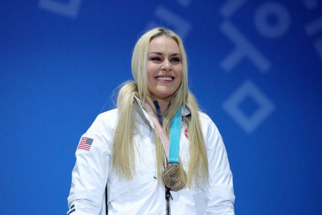 Lindsey Vonn on stage with her medal.