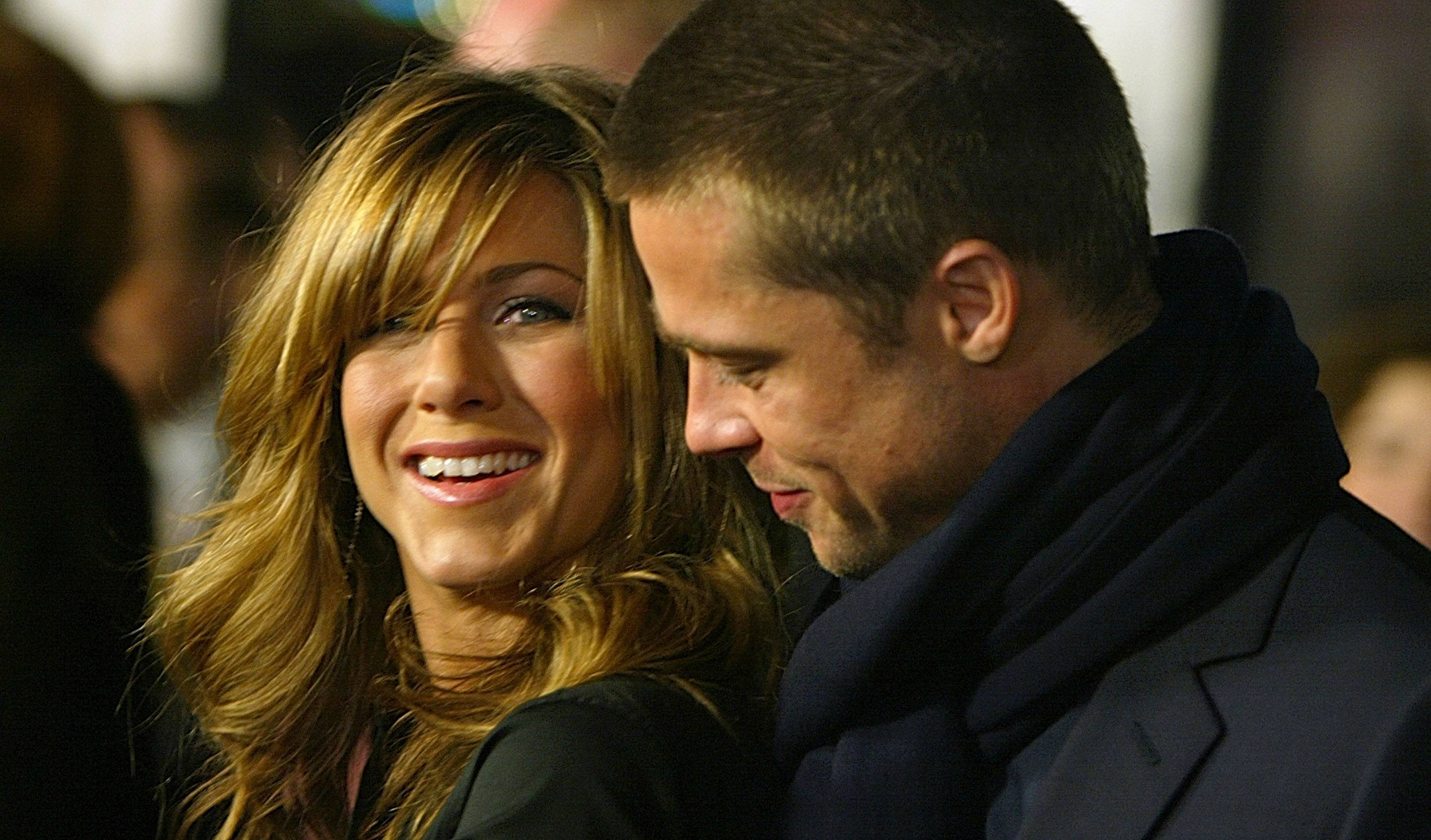 Actress Jennifer Aniston and actor Brad Pitt attend the Los Angeles premiere of Universal Pictures' film 'Along Came Polly'