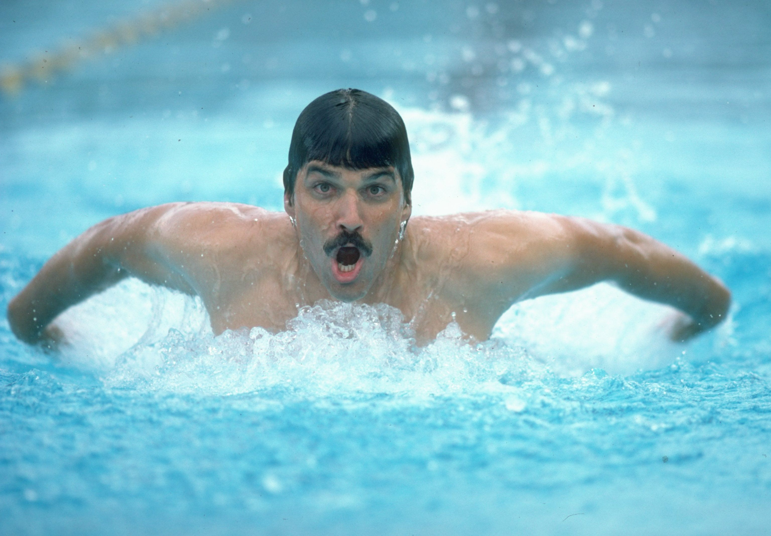 Mark Spitz swimming without goggles or a swim cap