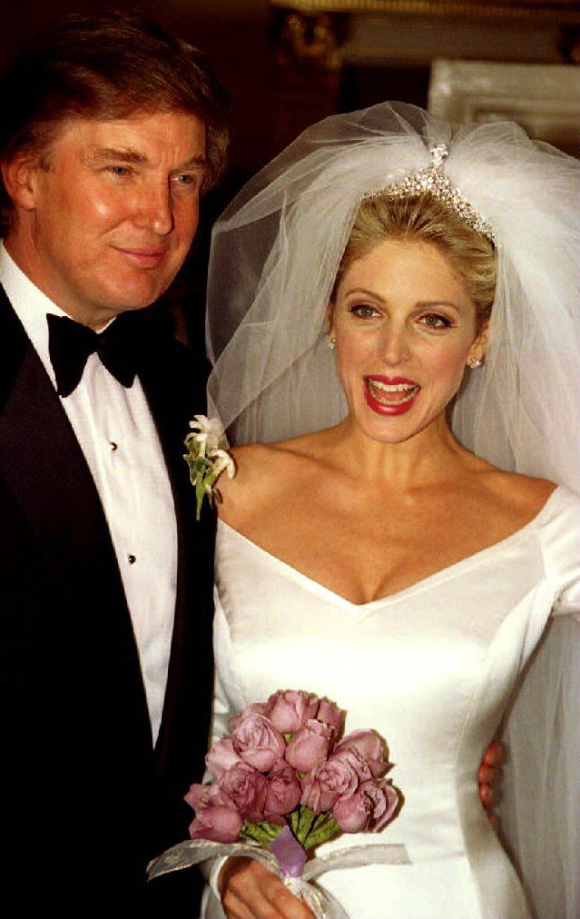 Donald Trump and Marla Maples appear in front of t