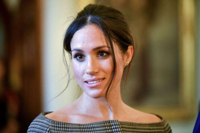 Meghan Markle looking straight ahead.