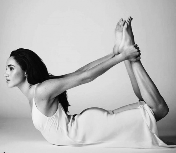 Meghan Markle in a yoga pose during a photoshoot.