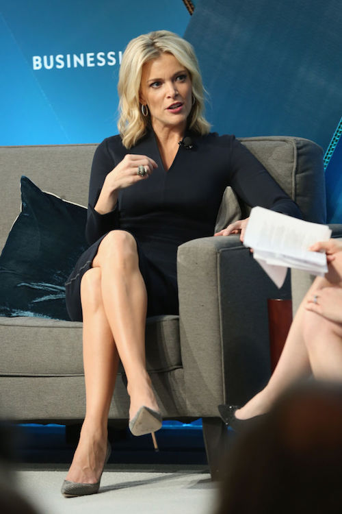 Megyn Kelly sitting on a couch wearing high heels and a skirt.