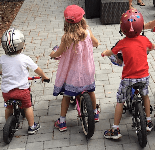 Megyn Kelly's three children playing on bikes.