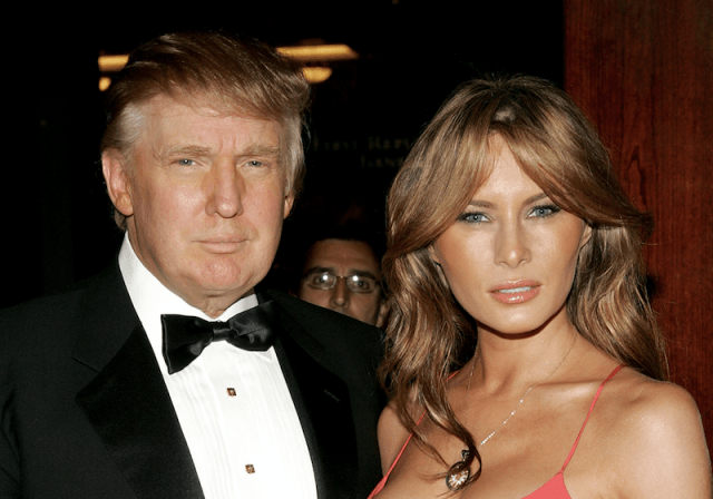Melania Trump and Donald Trump posing together at a formal event.
