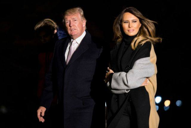 President Donald Trump and First Lady Melania Trump walk together.
