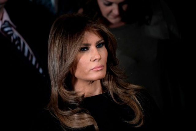 Melania Trump looking somber or angry.