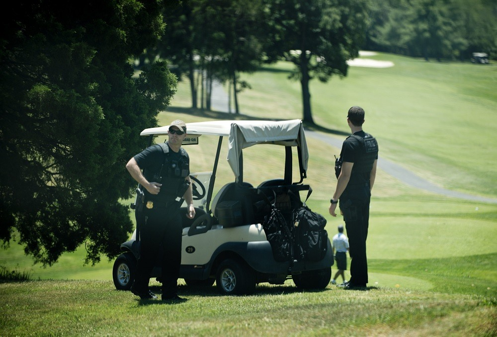 Members of the Secret Service watch over a golf course at Fort Belvoir before US President Barack Obama
