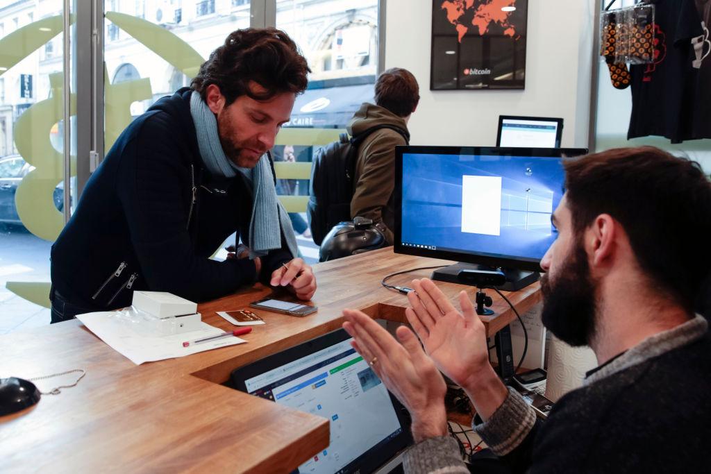 Man buying bitcoin in France