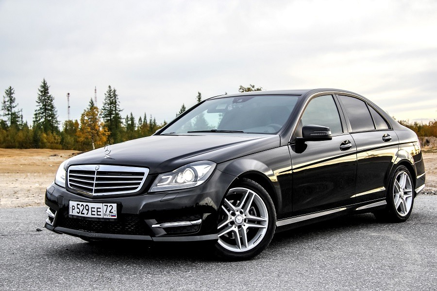 Mercedes-Benz W204 C-class is parked at the countryside.