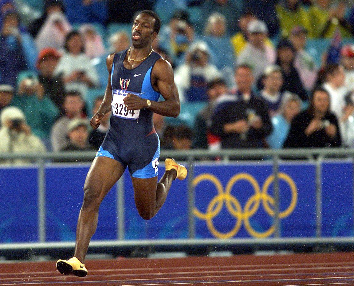 Michael Johnson wears gold shoes