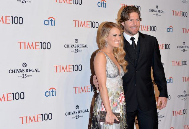 Carrie Underwood posing with Mike Fisher.