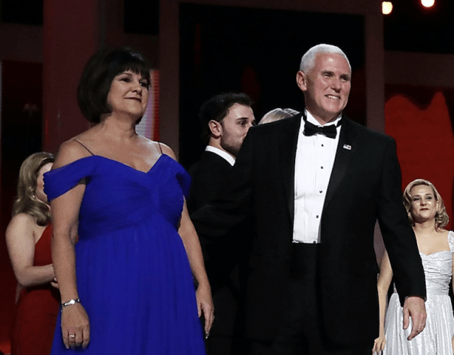 Mike Pence and his wife stand together at a ball.