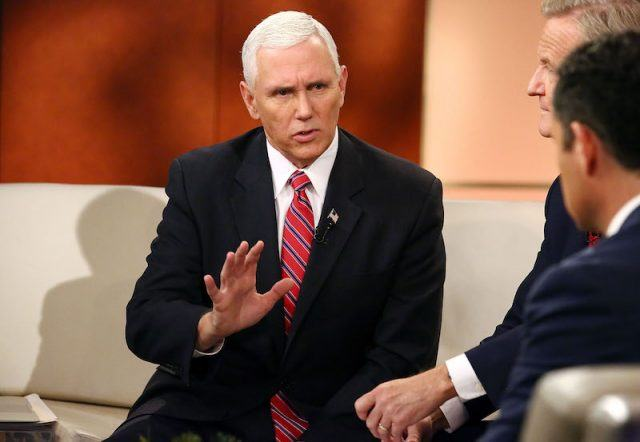Mike Pence sitting during an interview.