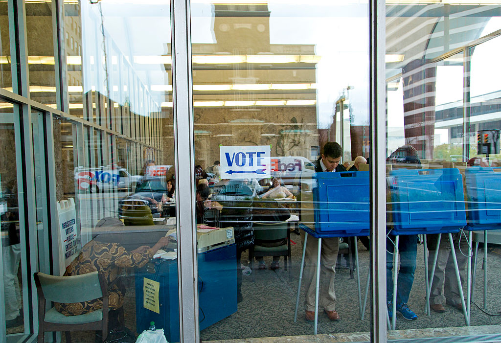 Citizens go to the cast their ballots at the city hall building on election day November 4, 2014 in Milwaukee, Wisconsin