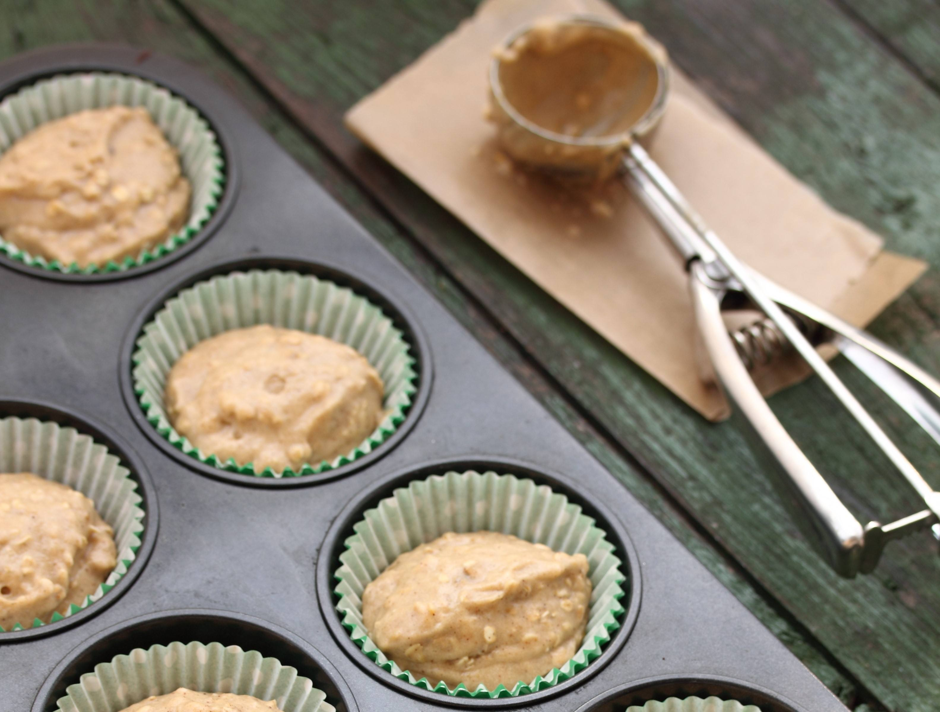 Muffin batter with an ice cream scoop