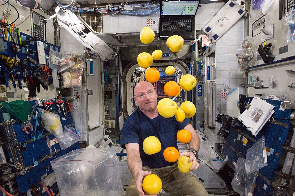 NASA astronaut Scott Kelly corrals the supply of fresh fruit that arrived on the Kounotori 5 H-II Transfer Vehicle