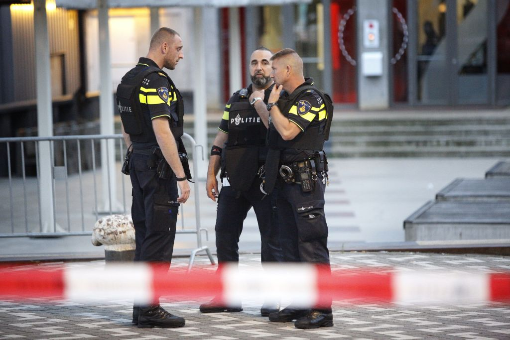 Police stand during the evacuation the Maassilo concert venue