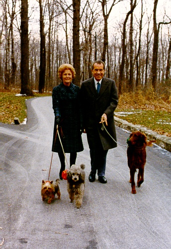 Richard Nixon and his wife walking their dogs