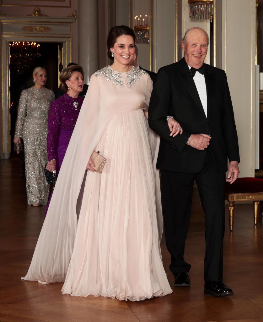 Britain's Catherine, Duchess of Cambridge walks with Norway's King Harald