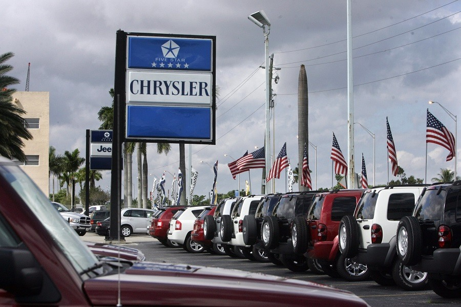 New cars for sale sit in a lot at a local Chrysler dealership