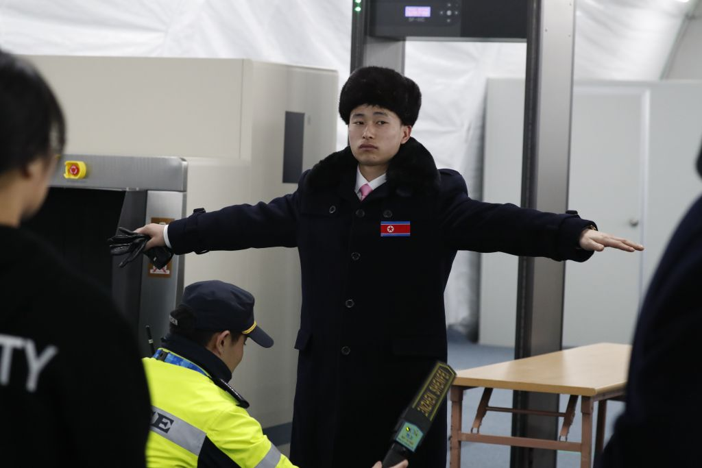 North Korean delegate is searched at Olympics