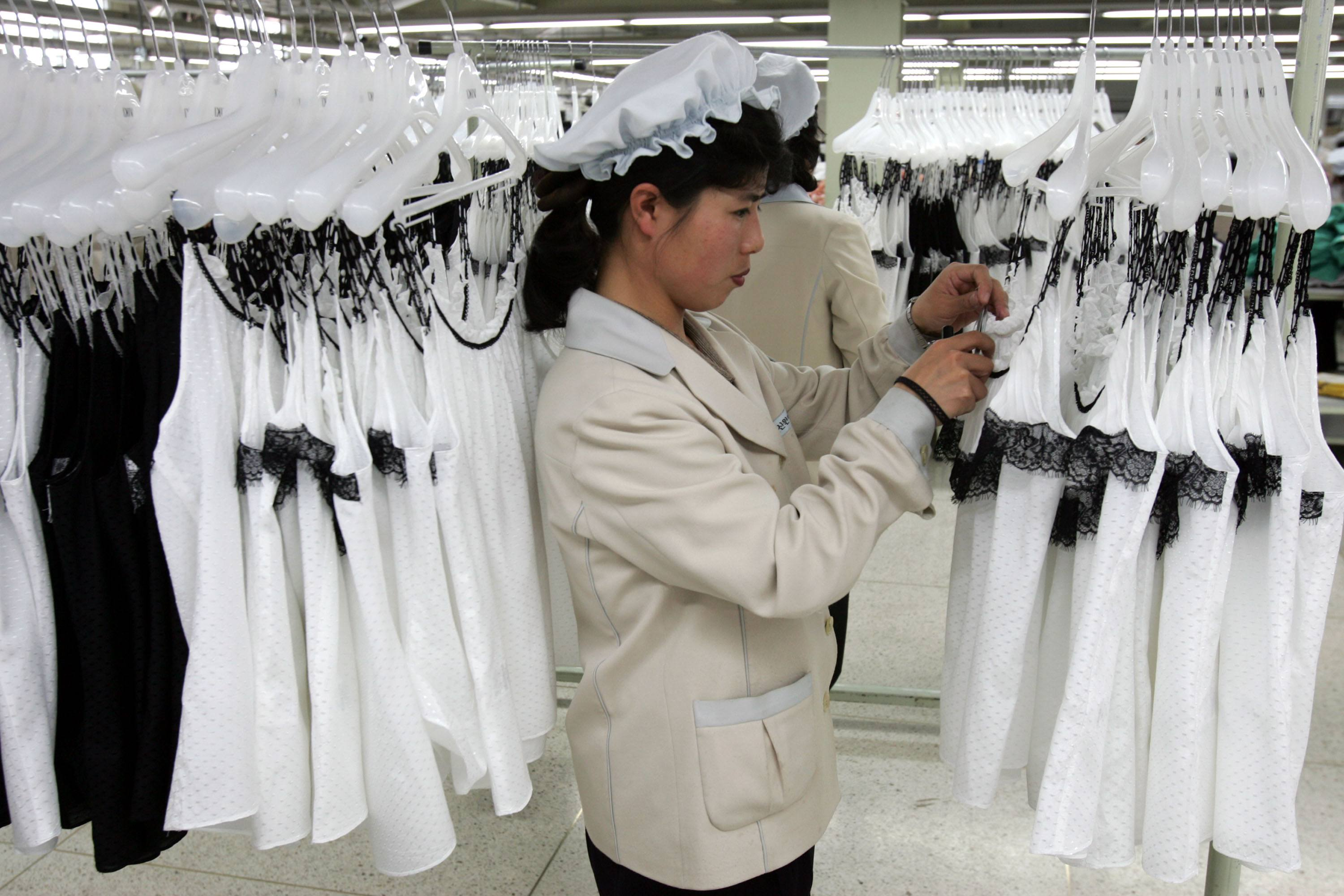 North Korean women work at the assembly line of the factory of South Korean textile company